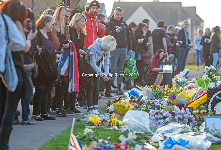 Fans look at the floral tribute in the church grounds after the funeral of the late  Prodigy singer Keith Flint at St Marys Church in Bocking,  Essex today.