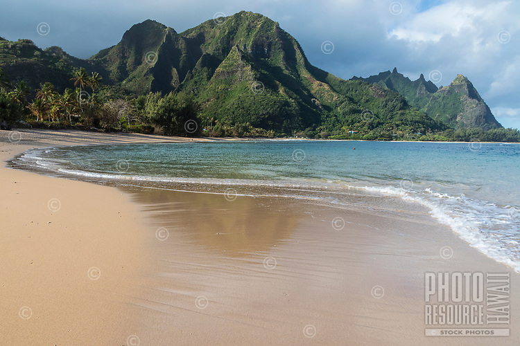 The view while walking the shore at Tunnels Beach, Ha'ena, Kaua'i; Mount Makana (nicknamed Bali Hai) is on the right of the mountain range.