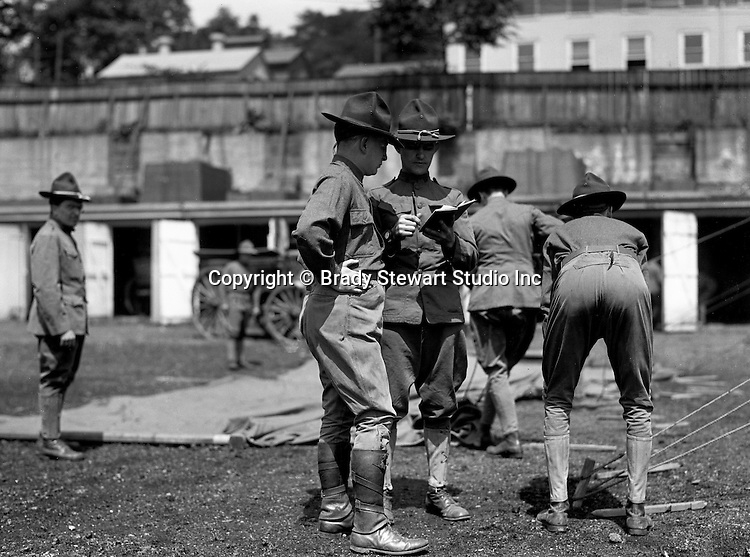 Petersburg VA:  Soldiers pitching a tent at bootcamp,  80th Division encampment - 1918