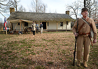 NWA Democrat-Gazette/ANDY SHUPE<br /> Tom Yancey of Springdale, portraying a soldier from the Army of the Trans-Mississippi, stands guard Saturday, Feb. 9, 2019, outside the historic Morrow House during a Living History Day at Prairie Grove Battlefield State Park. The day featured living history presenters at several locations around the park as well as a live-fire infantry/musket demonstration.