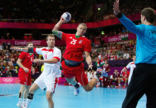 29 JUL 2012 - LONDON, GBR - Szabolcs Zubai (HUN) of Hungary (centre) shoots during the men's London 2012 Olympic Games Preliminary round handball match against Denmark at The Copper Box in the Olympic Park, in Stratford, London, Great Britain .(PHOTO (C) 2012 NIGEL FARROW)