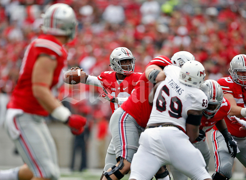 Ohio State Buckeyes quarterback J.T. Barrett (16) throws a touchdown pass to Ohio State Buckeyes wide receiver Michael Thomas (3) against Northern Illinois Huskies in the 2nd quarter of their game at Ohio Stadium on September 19, 2015.  (Dispatch photo by Kyle Robertson)