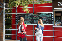 Girls read chalk board menu in Gorky park, Moscow