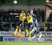 3rd December 2019; Pirelli Stadium, Burton Upon Trent, Staffordshire, England; English League One Football, Burton Albion versus Southend United; Richard Nartey of and Lucas Akins of Burton Albion jump up in the air to head the ball infant of Stephen Humphrys of Southend United  - Strictly Editorial Use Only. No use with unauthorized audio, video, data, fixture lists, club/league logos or 'live' services. Online in-match use limited to 120 images, no video emulation. No use in betting, games or single club/league/player publications