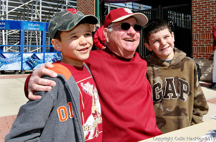 TALLAHASSEE, FL 2/13/10-FSU-BSB FANDAY10 CH12-Florida State Head Coach Mike Martin poses for a photo with Tyler, age 7 and Quincy Daigle, age 8 both of Tallahassee during Fan Day Saturday in Tallahassee...COLIN HACKLEY PHOTO