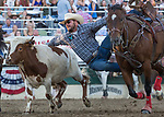 Cade Goodman competes in the Steer Wrestling event during the Reno Rodeo on Sunday, June 23, 2019.