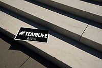 A sign is left behind by Pro-Life activists after a rally outside the United States Supreme Court in Washington D.C., U.S., on Monday, June 29, 2020.  The Court delivered a 5-4 ruling blocking a restrictive abortion law in Louisiana Monday morning.  Credit: Stefani Reynolds / CNP /MediaPunch