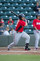 Raudy Read (21) of the Potomac Nationals follows through on his swing against the Winston-Salem Dash at BB&T Ballpark on May 13, 2016 in Winston-Salem, North Carolina.  The Dash defeated the Nationals 5-4 in 11 innings.  (Brian Westerholt/Four Seam Images)