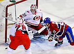 31 March 2010: Carolina Hurricanes' goaltender Cam Ward makes a first period save against Montreal Canadiens right wing forward Brian Gionta at the Bell Centre in Montreal, Quebec, Canada. The Hurricanes defeated the Canadiens 2-1 in their last meeting of the regular season. Mandatory Credit: Ed Wolfstein Photo