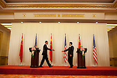 Beijing, China - November 17, 2009 -- United States President Barack Obama and Chinese President Hu Jintao reach out to shake hands after a press conference at the Great Hall of the People in Beijing, China, Tuesday, November 17, 2009.  .Mandatory Credit: Pete Souza - White House via CNP