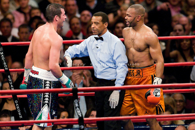 New York, Nov. 10th, 2008: Joe Calzaghe (black trunk) taunts  Roy Jones Jr. during their Ring Magazine Light Heavyweight Championship fight at  Madison Square Garden. Calzaghe won by unanimous decision. Photo by Thierry Gourjon.