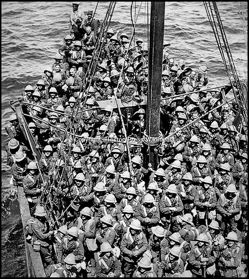 BNPS.co.uk (01202 558833)Pic: HistoryPress/Wikimedia/BNPS<br /> <br /> Lancashire Fusiliers boat Gallipoli, May 1915. <br /> <br /> The remarkable story of a humble street which was described by the king as 'the bravest in England' is told in a new book.<br /> <br /> The inhabitants of Chapel Street in Altrincham, Greater Manchester, displayed an unrivalled devotion of duty when Lord Horatio Kitchener made the rallying call for men to enlist in the First World War.<br /> <br /> From the tight-knit community of just 60 houses, a staggering 161 men volunteered - 81 of them on the first day.<br /> <br /> Tragically, however, 29 men from the street were killed in action, more than from any other street in England.
