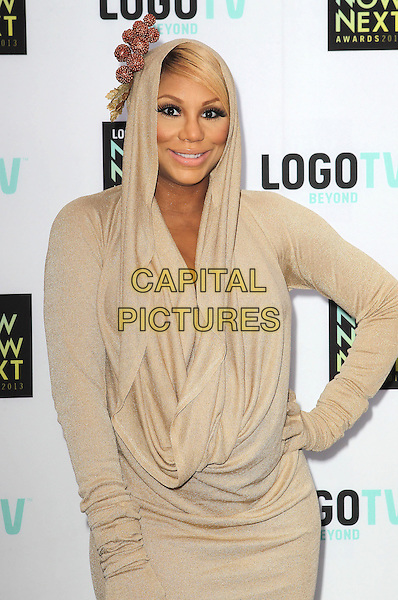 Tamar Braxton.2013 NewNowNext Awards held at The Fonda Theatre, Los Angeles, California, USA, 13th April 2013..half length beige nude hood dress ruched hoodie hooded long sleeve gloves  gold   .CAP/ADM/KB.©Kevan Brooks/AdMedia/Capital Pictures