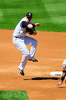 01 September 2008: Colorado Rockies 2nd baseman Clint Barmes makes a play towards 1st base on a double play against the San Francisco Giants. The Rockies defeated the Giants 5-0 at Coors Field in Denver, Colorado. FOR EDITORIAL USE ONLY