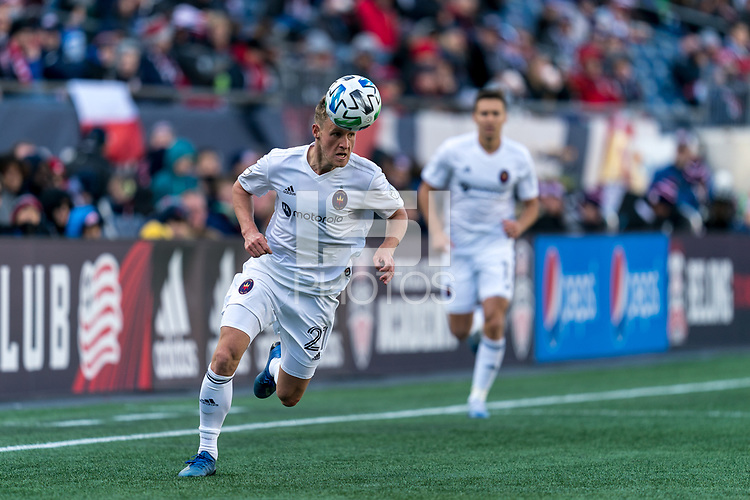 FOXBOROUGH, MA - MARCH 7: Fabian Herbers #21 of Chicago Fire controls the ball with his head as he brings ball down the wing during a game between Chicago Fire and New England Revolution at Gillette Stadium on March 7, 2020 in Foxborough, Massachusetts.