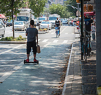 A hoverboard in use in a bike lane in New York on Friday, July 22, 2016.  (© Richard B. Levine)