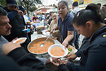 "Juani Martinez and other Methodists in Nuevo Laredo, Mexico, serve food to Cuban immigrants in that city's Plaza Benito Juarez on March 3, 2017. Hundreds of Cubans are stuck in the border city, caught in limbo by the elimination in January of the infamous ""wet foot, dry foot"" policy of the United States. They are not allowed to enter the U.S. yet don't want to return to Cuba. Many of the city's churches have become temporary shelters for the immigrants, and congregations rotate responsibility for feeding the Cubans, who have slowly been forced to appreciate Mexican cuisine. Such solidarity from ordinary Mexicans is being tested these days, as not only are the Cubans stuck at the border, but the U.S. has stepped up deportations of Mexican nationals, while at the same time detaining many undocumented workers from other nations and simply dumping them on the US-Mexico border. Martinez is a member of the Aposento Alto Methodist Church in Nuevo Laredo."