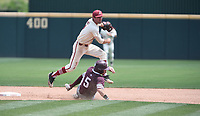 NWA Democrat-Gazette/J.T. WAMPLER Arkansas' Jack Kenley watches his throw to first base after tagging Texas A&M's Logan Foster at second Sunday May 13, 2018 at Baum Stadium in Fayetteville. Arkansas won 6-3 to sweep the three game series.