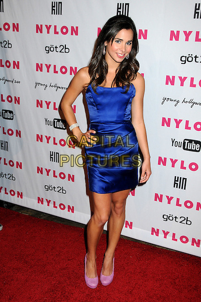 JOSIE LOREN.Nylon Magazine's Young Hollywood Party held at the Roosevelt Hotel's Tropicana Bar, Hollywood, California, USA..May 12th, 2010.full length blue purple silk satin dress pink shoes hand on hip strapless.CAP/ADM/BP.©Byron Purvis/AdMedia/Capital Pictures.