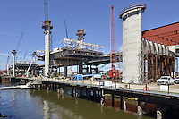 Pearl Harbor Memorial Bridge, New Haven Harbor Crossing Corridor, Interstate 95 in CT. Construction of Connecticut Department of Transportation Contract B as seen on September 9, 2011. New Northbound Span, Progress of the Replacement Bridge. When complete this will be the first Extradosed Bridge in the United States. This view includes Traveling Formwork, East and West Towers, cranes and platforms.