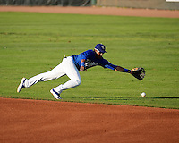 Jesmuel Valentin (6) of the Ogden Raptors dives for the grounder as the Raptors faced the Great Falls Voyagers in Pioneer League play at Lindquist Field on August 14, 2013 in Ogden Utah. (Stephen Smith/Four Seam Images)
