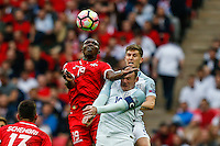 Alfred Effiong of Malta (left) beats Wayne Rooney (Manchester United) of England (right) in an aerial battle during the FIFA World Cup qualifying match between England and Malta at Wembley Stadium, London, England on 8 October 2016. Photo by David Horn / PRiME Media Images.