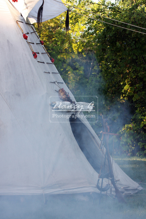 Native American Indian tipi with smoke from a campfire