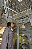 Jeannette Epps, a member of the Astronaut Class of 2009, looks up at the open area inside a flight-ready version of Skylab, the first United States Space Station launched in the early 1970s , on display at the National Air and Space Museum in Washington, D.C. on Friday, July 17, 2009.  <br /> Credit: Ron Sachs / CNP