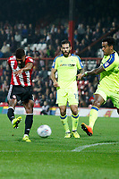 Ollie Watkins of Brentford gets a shot away during the Sky Bet Championship match between Brentford and Derby County at Griffin Park, London, England on 26 September 2017. Photo by Carlton Myrie / PRiME Media Images.