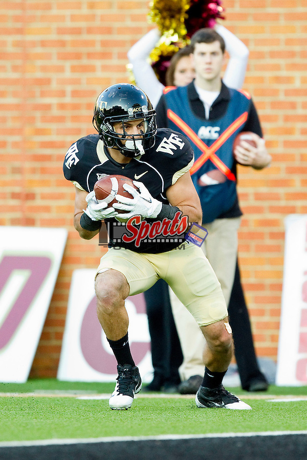 Michael Campanaro (3) of the Wake Forest Demon Deacons catches his third touchdown of the first half against the Boston College Eagles at BB&T Field on November 3, 2012 in Winston-Salem, North Carolina.  The Demon Deacons defeated the Eagles 28-14.  (Brian Westerholt/Sports On Film)
