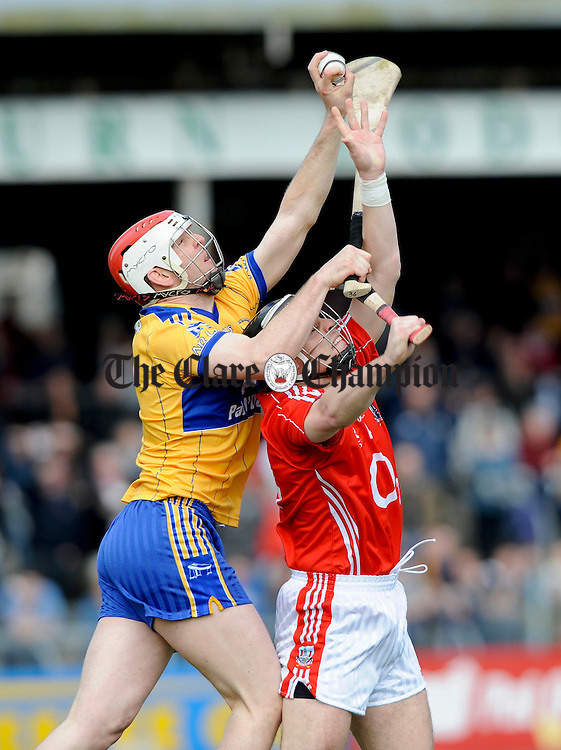 Clare's Cathal Dillon collects the ball above Cork's Neil Ronan during their NHL game at Cusack Park. Photograph by John Kelly.