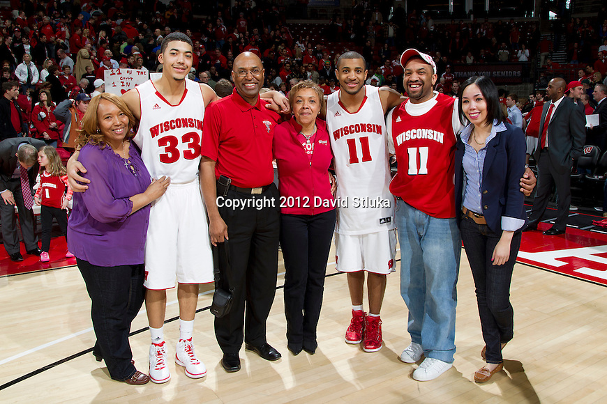 Wisconsin Badgers seniors Rob Wilson (33) and Jordan Taylor (11) pose with their families after a Big Ten Conference NCAA college basketball game against the Illinois Fighting Illini on Sunday, March 4, 2012 in Madison, Wisconsin. The Badgers won 70-56. (Photo by David Stluka)