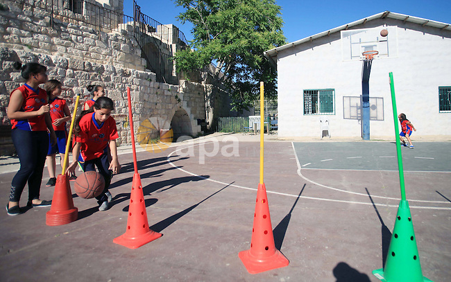 Palestinian girls attend a basketball training in Jerusalem's Old City, April 30, 2014. The team is the first women's team belonging to the sons of Jerusalem club, and consists of about 70 girl between the ages of 10 to 20 years. Photo by Saeed Qaq
