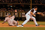 24 August 2007:  Washington Nationals catcher, Jesus Flores, slides into third base during the Rockies 6-5 victory over the Washington Nationals at Coors Field, Denver Colorado.