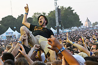 A man is crowd surfing during a concert at the Festival d'ete de Quebec in Quebec City Saturday July 14, 2012.