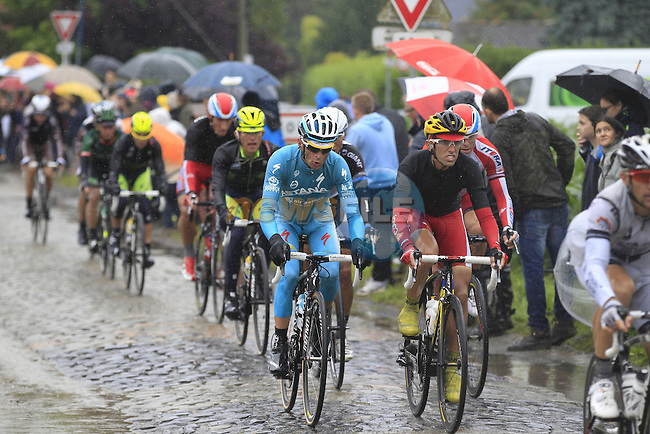 Riders including Michele Scarponi (ITA) Astana tackle the1st cobbled sector 9 from Gruson to Crossroads de l'Arbe during Stage 5 of the 2014 Tour de France running 155.5km from Ypres to Arenberg. 9th July 2014.<br /> Picture: Eoin Clarke www.newsfile.ie