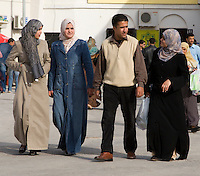 Tripoli, Libya, North Africa - Libyan Man, Women, at International Trade Fair.  Typical Clothing Styles.