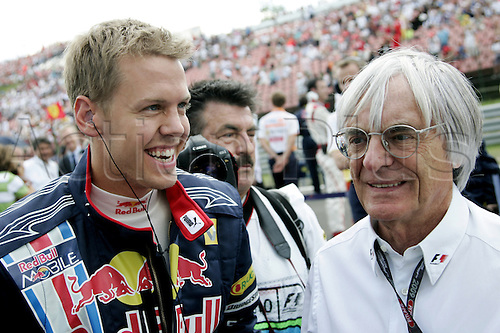 German Formula One driver Sebastian Vettel (L) of Red Bull and Formula One boss Bernie Ecclestone pictured prior to the Formula One Hungarian Grand Prix at Hungaroring race track in Mogyorod near Budapest, Hungary, 26 July 2009. Photo: FELIX HEYDER /Actionplus. Editorial Use UK.