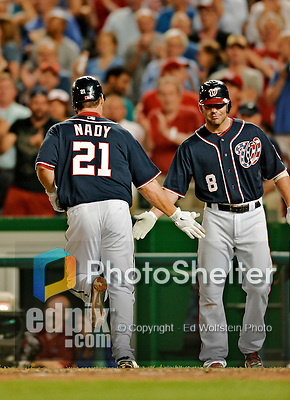 16 May 2012: Washington Nationals outfielder Xavier Nady returns to the dugout after hitting his 100th career home run during a game against the Pittsburgh Pirates at Nationals Park in Washington, DC. The Nationals defeated the Pirates 7-4 in the first game of their 2-game series. Mandatory Credit: Ed Wolfstein Photo