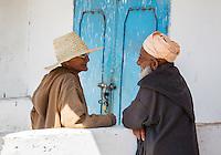 Morocco.  Two Old Men Talking, Had Draa Market, Essaouira Province.