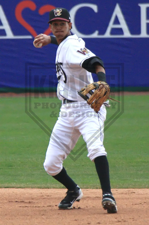 APPLETON - APRIL 2010: Carlos George of the Wisconsin Timber Rattlers, Class-A affiliate of the Milwaukee Brewers, in action during a game on April 10, 2010 at Fox Cities Stadium in Appleton, Wisconsin. (Photo by Brad Krause)