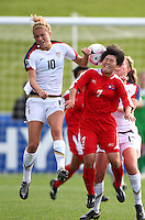 Kristie Mewis (L) and KIM Un Ju compete for a header. USA v Korea Republic. FIFA U-17 Women's World Cup Final. North Harbour Stadium, Auckland, Sunday 16 October 2008. Photo: Simon Watts/PHOTOSPORT
