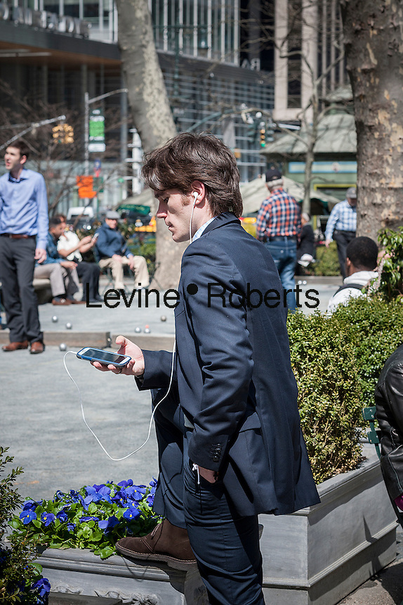 A visitor to Bryant Park in New York City enjoys warm weather during his lunch hour on Thursday, April 3, 2014.  Temperatures are expected to rise into the mid 60's with plenty of sun today and Friday but clouds and a chance of showers arrive over the weekend.  (© Richard B. Levine)