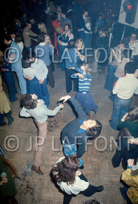 Poland, January 1977 - People eat, drink, and dance in a nightclub and restaurant underneath the main market in Krakow, Poland.