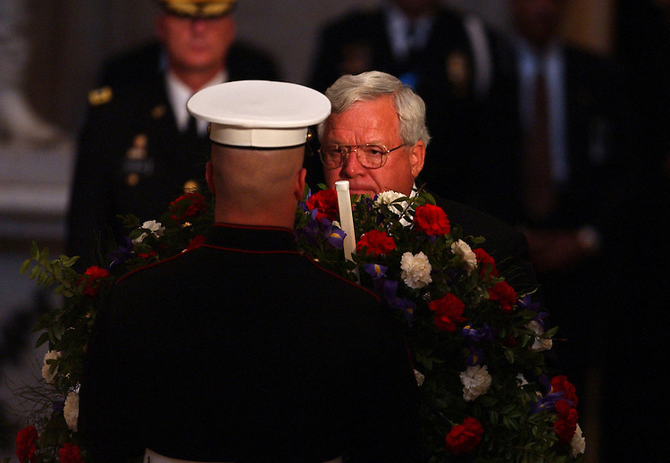 Speaker Dennis Hastert helps lay a wreath in  honoe of the late  Ronald Reagan, during a State Funeral held in the Rotunda of the U.S. Capitol.