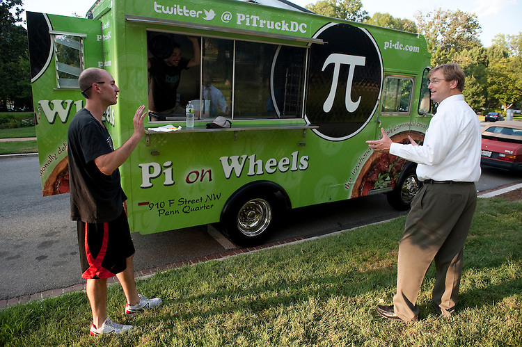 UNITED STATES - JULY 30: Sen. Dean Heller, R-Nev.,was disappointed to find out that the Pi on Wheels pizza truck was out of meat pizzas on Saturday afternoon, July 30, 2011. Pi on Wheels was offering free pizzas to anyone with a Senate ID in hopes of helping the Senate come to an agreement on the debt ceiling. (Photo By Bill Clark/Roll Call)