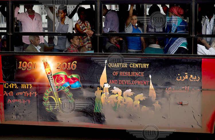 A poster on the side of a bus celebrating 25 years of independence under the slogan 'Quarter Century of Resilience and Development.'