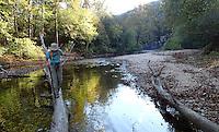 NWA Democrat-Gazette/FLIP PUTTHOFF <br /> Karen Mowry crosses North Sylamore Creek on Oct. 30 2016 during a hike on the North Sylamore Creek Trail.