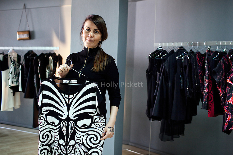 "Turkish fashion designer Gul Agis with a tunic from the ""Anger"" collection, based on the 2013 Gezi Park protests, in her showroom in Istanbul, Turkey, January 21, 2014. She said she likes to experiment with creative materials and often picks a social or political issue as a theme to her collections. Traditional Mauri tribe masks and carvings inspired the ""Anger"" collection. Agis started her own fashion brand, Lug von Siga, four years ago. Over the past decade, Turkey's fashion design scene has expanded and is beginning to be competitive internationally, with a bi-annual Istanbul Fashion Week, a 165-member fashion designer's association, and more than 20 institutions of higher education that offer fashion design courses of study. Where once Turkey was seen primarily a manufacturer of textiles, now Turkey's top designers sometimes show collections on the catwalks of Paris, Milan, London, and New York."