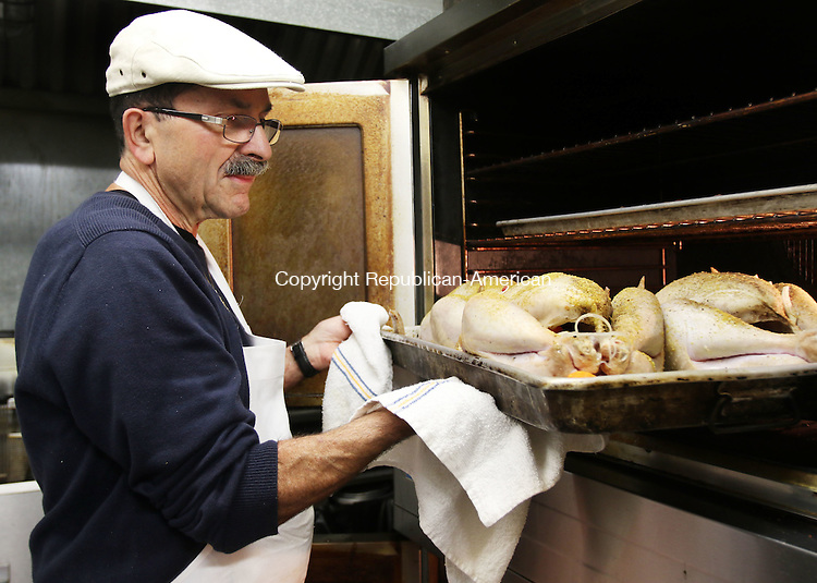 WATERBURY CT. 21 November 2016-112116SV03-Pat Lacerenza of the Elks club cooks 10 turkeys for the First Congregational Church Thanksgiving dinner at the club in Waterbury Monday. The Elks donated 200 turkeys to organizations through the Bill Wildman Memorial turkey drive at the club.<br /> Steven Valenti Republican-American